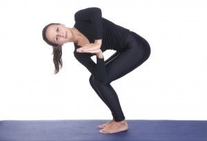 Parivritta Utkatasana - Chair Twist yoga pose